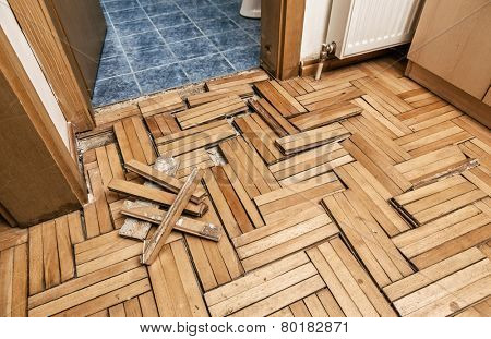 Damaged wooden floor -Ruined flooring from moisture and water from bathroom