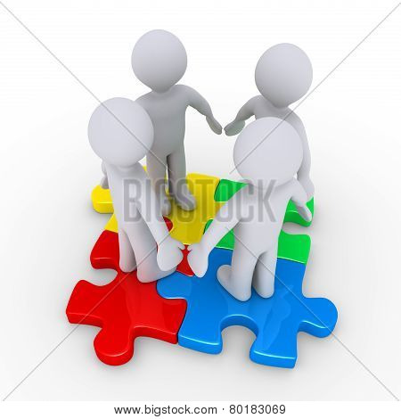 Four People On Colored Puzzle Pieces