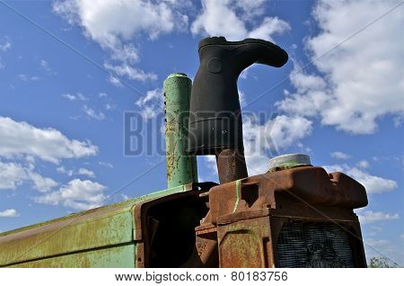 Boot placed over tractor exhaust opening