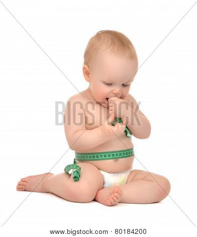 Infant Child Baby Toddler Sitting Playing With Tape Measure Measuring Body