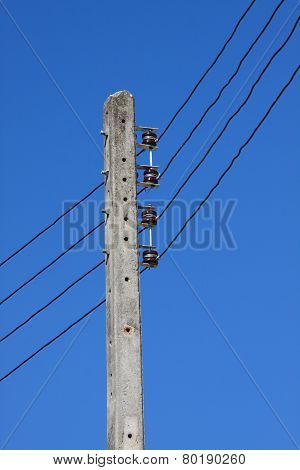 Electrical wire on pole. chaotic wire with nest on pole and blue sky background