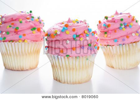 Three cupcakes with sprinkles