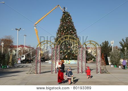 Ashgabat, Turkmenistan - Circa December 2014: Preparation Of The Christmas Fir-tree On A Square Of T