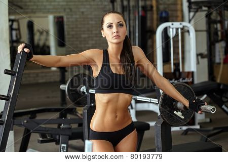 Shapely muscular girl posing in gym