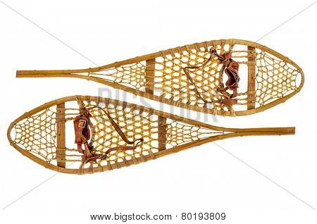 a pair of vintage wooden Huron snowshoes with leather binding isolated on white