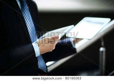 close up hands multitasking man using tablet laptop and cellphone connecting wifi