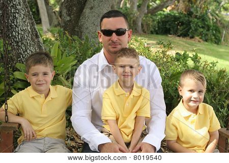 Handsome dad with happy boys