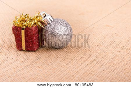 Two Christmas ornaments on burlap, a simple design with old time feel