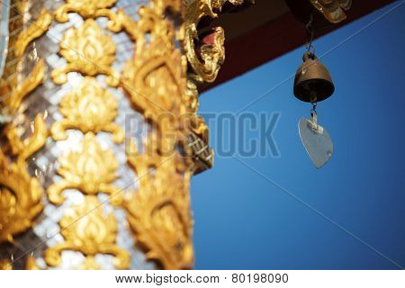 thai temple roof and bell with blue sky northern of Thailand