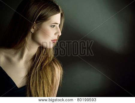 Profile side portrait of young woman