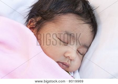 Portrait of a Sleeping Newborn Baby Girl