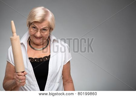 Elderly woman with rolling pin