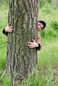 Man Hugging Tree
