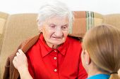 picture of geriatric  - Young carer wrap the elderly woman with warm sweater - JPG