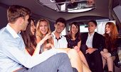 foto of limousine  - Happy friends chatting in limousine on a night out - JPG