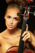picture of cello  - Photo golden beautiful female musician playing a cello - JPG