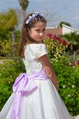 foto of communion  - A young girl smiling and celebrating her First Holy Communion - JPG