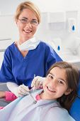 picture of pediatrics  - Smiling pediatric dentist with a happy young patient in dental clinic - JPG