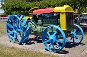 image of playground  - Old tractor painted with may colors park in outdoor playground - JPG