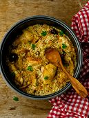foto of stew pot  - Stewed chicken with rice and dates in the crock - JPG