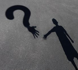 foto of underage  - Child care question or childcare uncertainty concept as a cast shadow of a youth reaching out to a symbol for questions as a metaphor for solutions for helping children in need - JPG