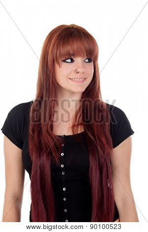 Teenage girl dressed in black with a piercing looking at side isolated on white background