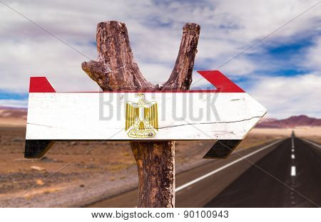 Egypt Flag wooden sign with desert road background