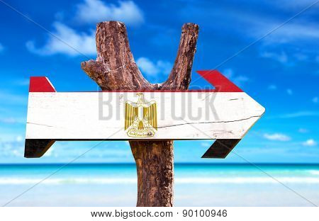 Egypt Flag wooden sign with ocean background