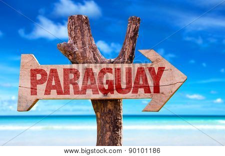 Paraguay wooden sign with lake background