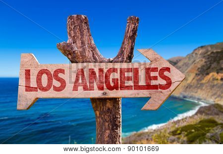 Los Angeles wooden sign with coast background