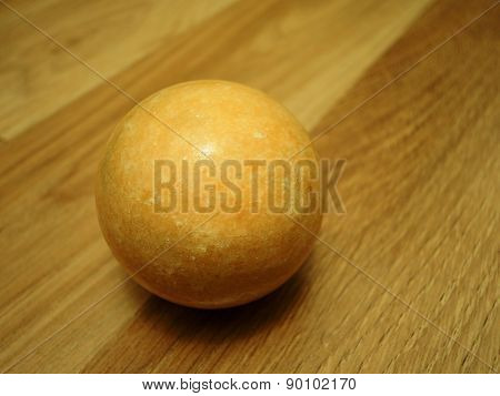 brown ball on parquet tiles
