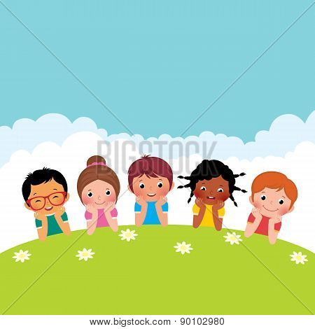Group Of Happy Children Boys And Girls Lying On The Grass