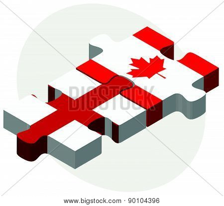 England And Canada Flags In Puzzle