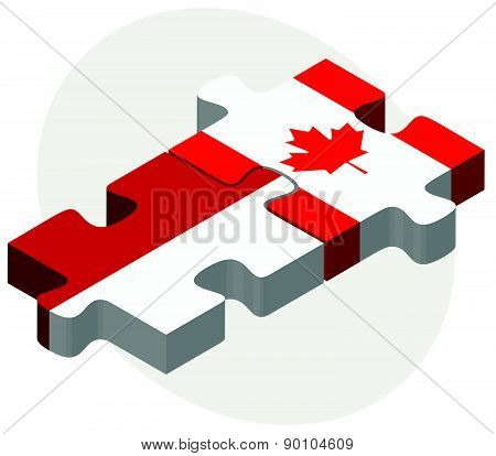 Indonesia And Canada Flags In Puzzle