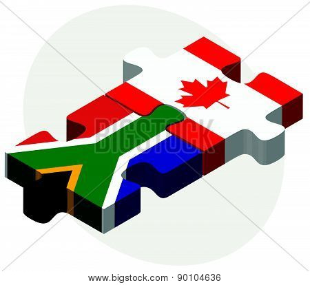 South Africa And Canada Flags In Puzzle
