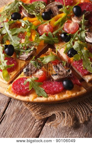 Pizza With Rucola, Salami And Olives Vertical Top View