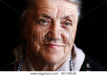 A portrait of a thoughtful granny