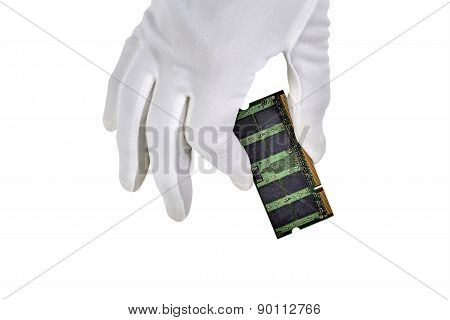 Gloved Hand Holding Circuit Board