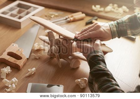 Craftsman Building A Wooden Toy Airplane