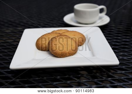 Butter Cookies With Espresso On Patio Table