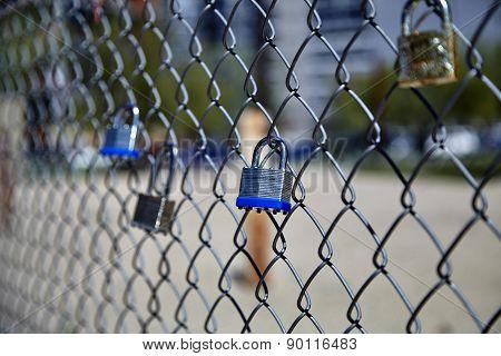 Padlocks Hanging On Fence