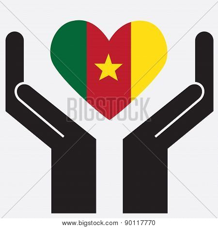 Hand showing Cameroon flag in a heart shape.