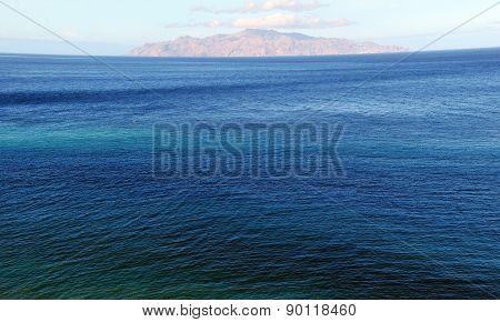 Multicolored Sea Leading To The Island
