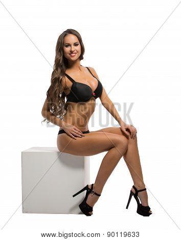 Glamorous underwear model posing at camera