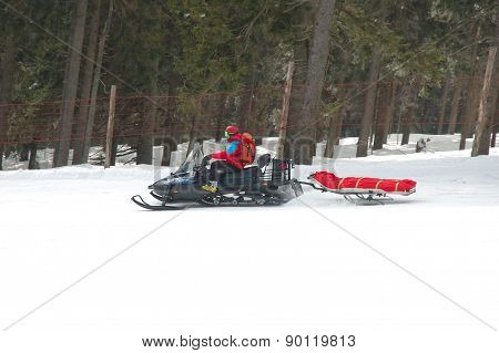 Rescue Worker On Snowmobile