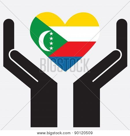 Hand showing Comoros flag in a heart shape.