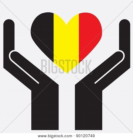 Hand showing Belgium flag in a heart shape.