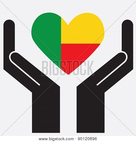 Hand showing Benin flag in a heart shape.
