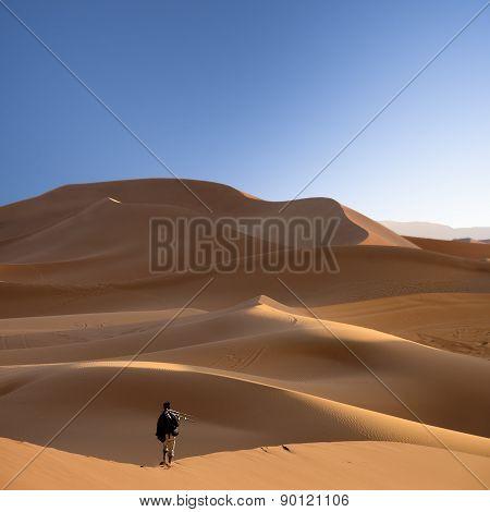 Photographer In The Sahara Desert, Morocco