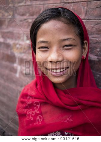 Bhaktapur, Nepal-oct 14 , 2012 : The Unidentified Girl Is Greeting People With Her Welcome And Naive